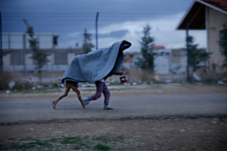 Syrian kids playing in 6 degrees celcius, the Bekaa valley Eastern Lebanon.